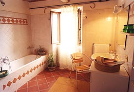 one of the bathrooms in the Holiday Villa Marche